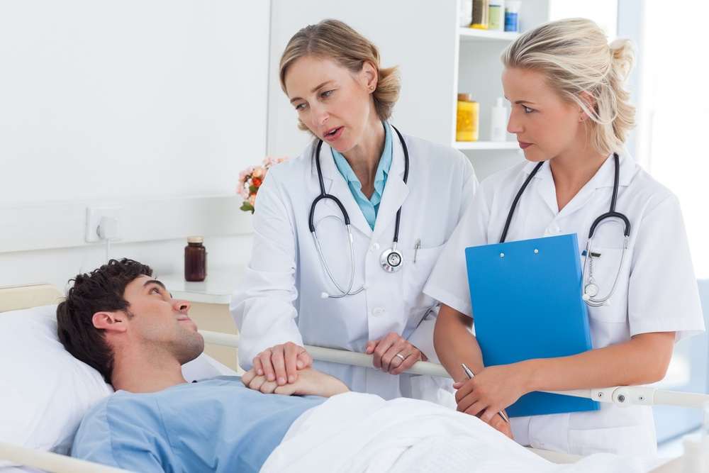 Doctors talking to a patient in hospital